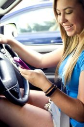 nice-teenage-girl-driving-while-attempting-to-text-one-of-her-friends-361x544